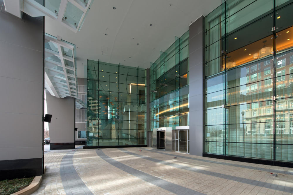 commercial building entry with exterior tile work and glass windows