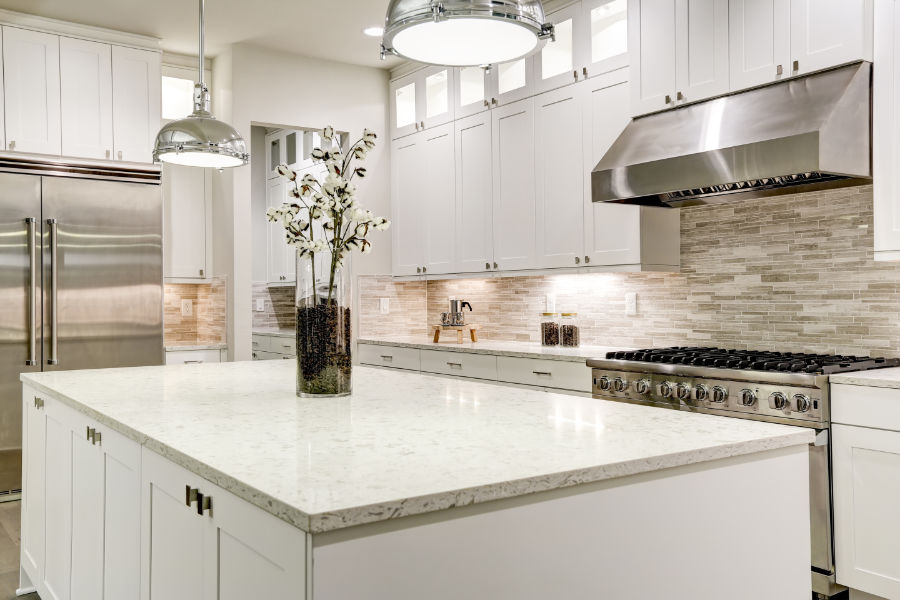 the inside of a beautiful open kitchen with with quartz countertops